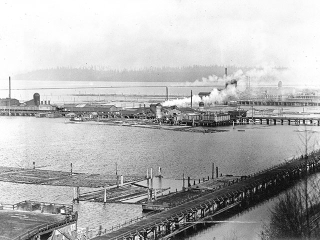 A northern facing view of the mills lined along the 14th Street Dock, circa 1915.   Photo courtesy of Everett Public Library.