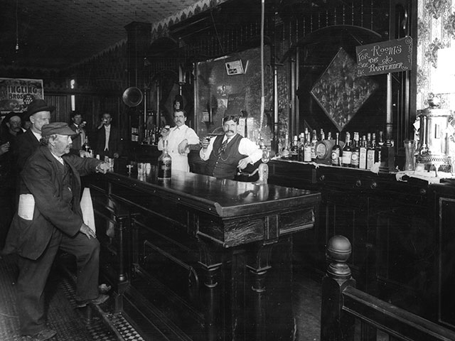 A typical Hewitt Avenue Saloon. In the left foreground, the patron's missing left hand fingers suggest he is a shingle weaver at a waterfront mill.  Photo courtesy of Everett Public Library.