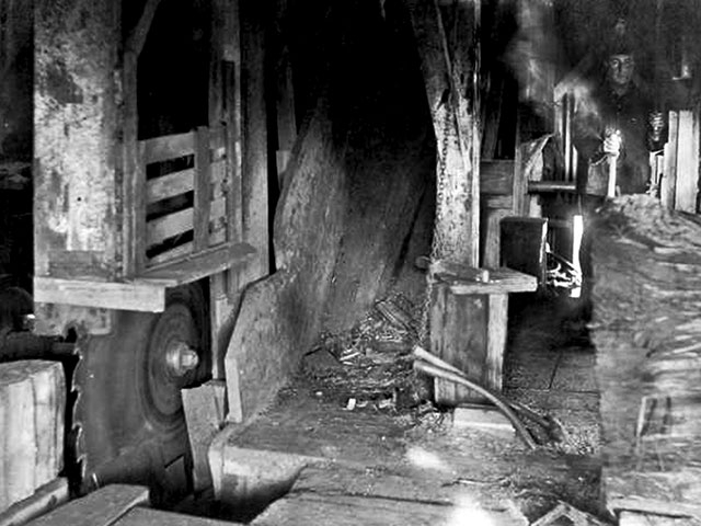 A lone shingle weaver is shown in this interior shot of a typical shingle mill.   Photo courtesy of Everett Public Library.