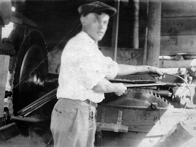 A shingle weaver operating machinery at one of the waterfront mills.   Photo courtesy of Larry and Jack O'Donnell.